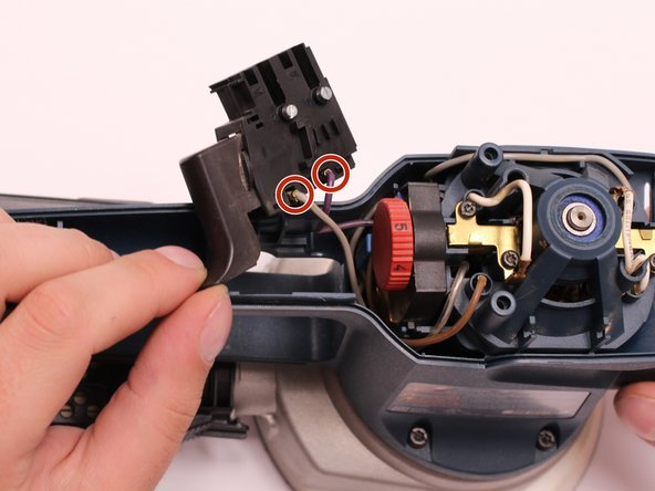 Remove the gray and purple wires by pulling on the wire terminals.