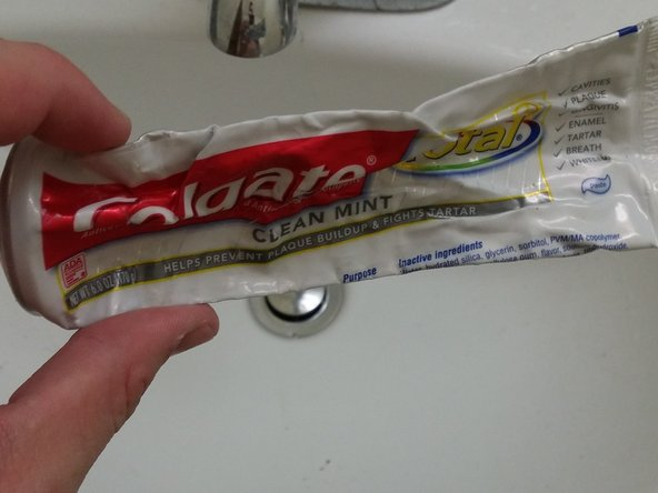 Take the toothpaste, and apply it to your index finger.