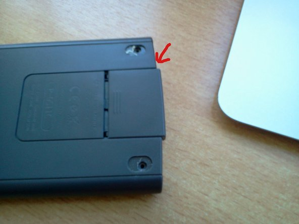 Remove the battery cover by sliding it out.