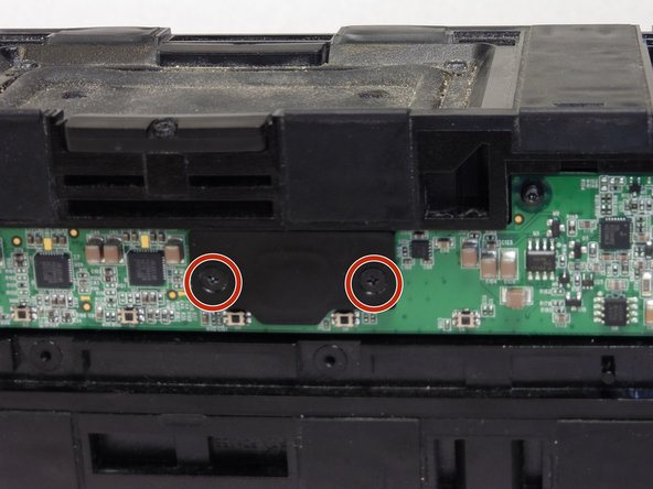 Remove the two PH0, 5.8 mm screws on the small plastic black panel using a screwdriver.