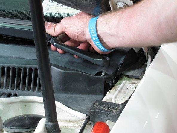 Remove the driver-side windshield wiper in the same fashion.