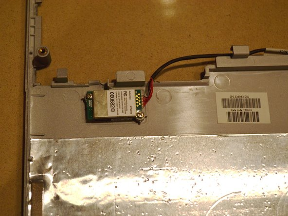 The Bluetooth module located above the battery or under the palmrest on the top right-hand side.