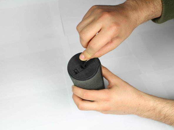 Remove the rubber port cover, peeling up from one end.