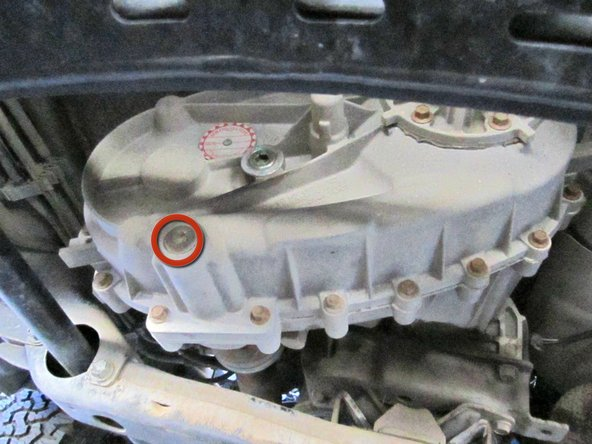 Set the drain pan underneath the transfer case. Make sure that the drain pan has enough room for about 2 quarts of oil.