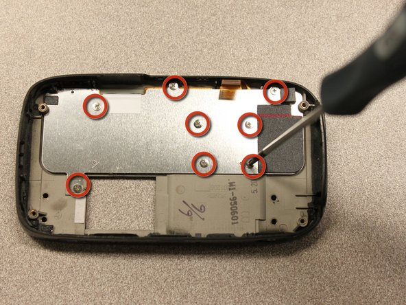 Use a screwdriver to remove eight 2mm Phillips screws that secure the keypad to the keyboard slider.