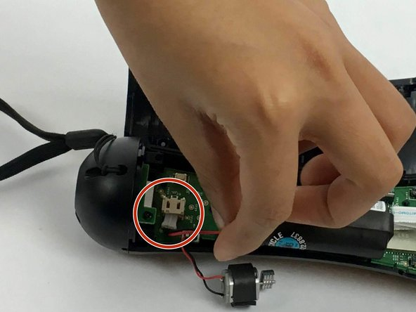 Gently pull on the white piece connecting the battery and the connector.