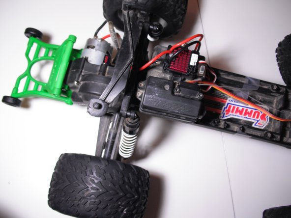 Lifting straight up, remove the plastic body from the truck, exposing the inner components.