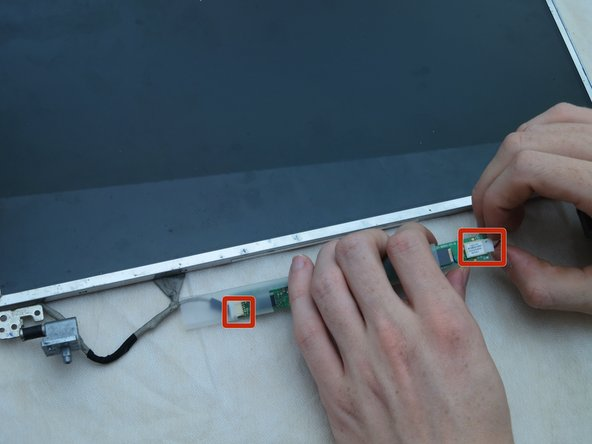 Using your hands, remove the small connectors from the small board attached to the bottom of the LCD screen.