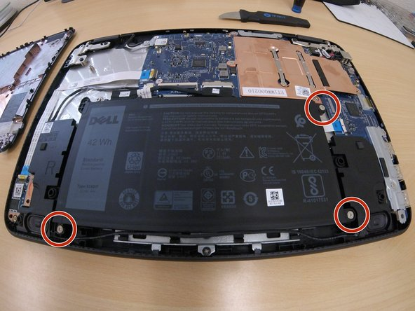 Remove the 3 battery screws with a phillips #00 screwdriver.