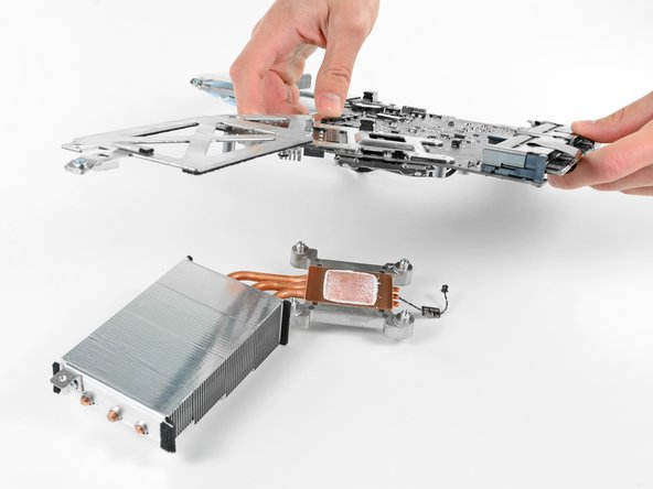 Carefully lift the logic board off the heat sink.