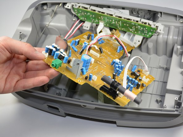 Lift the circuit board out of the radio.