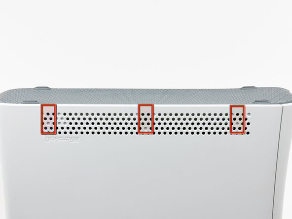 In the next few steps, you will use the tip of a spudger or the finger of an Xbox 360 opening tool to release the clips along the left and right sides of the bottom vent. Their locations are highlighted in red.