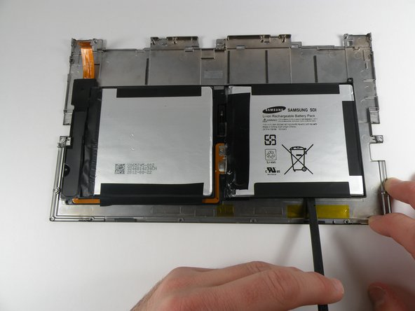 The battery is glued to the back cover but can be easily removed with a spudger