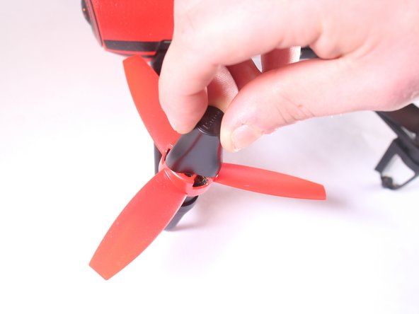 While holding the propeller in place, rotate the tool counterclockwise until the screws are aligned with the holes on the propeller.