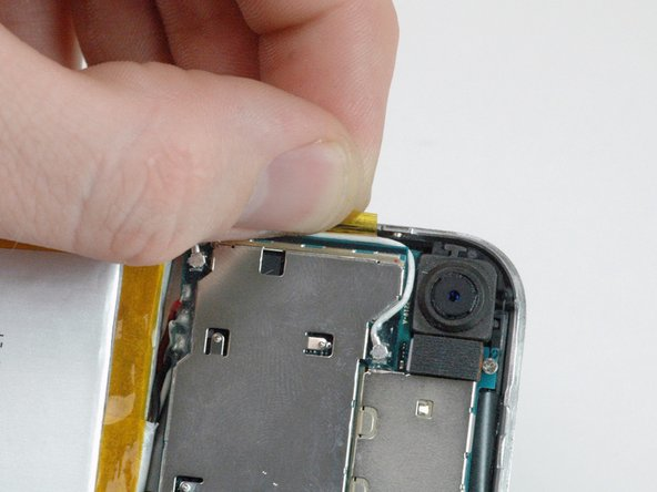 Peel up the orange tape securing the white antenna cable to the side of the iPhone.