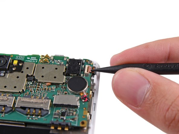 Use the tip of a spudger to flip open the tab on the digitizer ZIF connector.