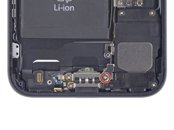 Remove the Phillips screw securing the Wi-Fi diversity antenna to  the rear case: