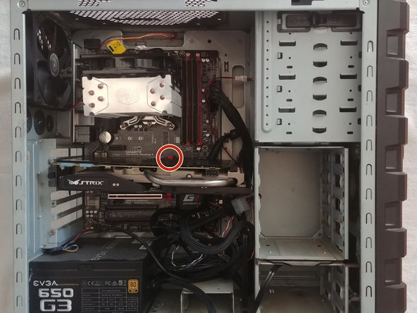 Press down the locking tab at the base of the GPU.