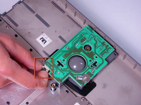 Locate the trackball assembly.  It is in the upper case and can be identified by a green circuit board.