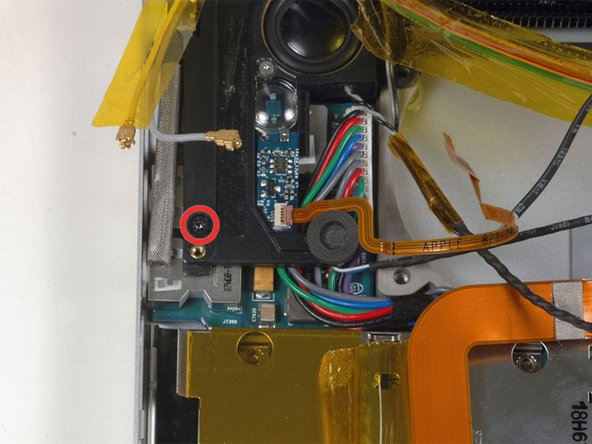 Remove the single black T6 Torx screw securing the left speaker.