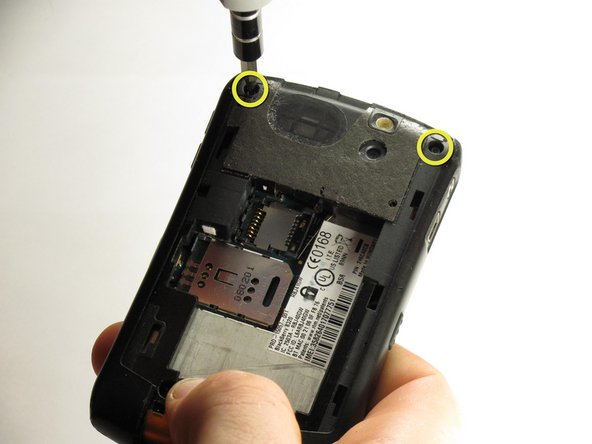 Remove the two top screws with a T5 Torx screwdriver.