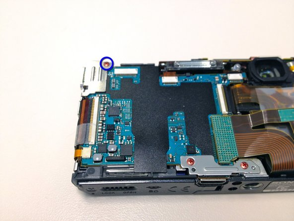 Remove the copper phillips screw holding the HDMI mounting plate and detach the mounting plate.