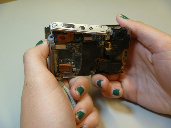 Pull apart the inner hardware from the back case by prying on the left side.