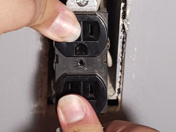 Push the outlet and wires back into the electrical box.