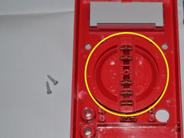 The dial is located in the central part of the device.