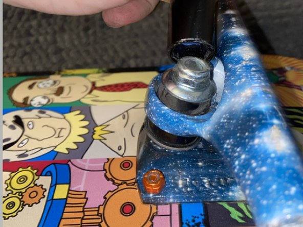 Using the T-Tool, unscrew the Kingpin nut, washer and top bushing so that the hanger itself can be taken off.