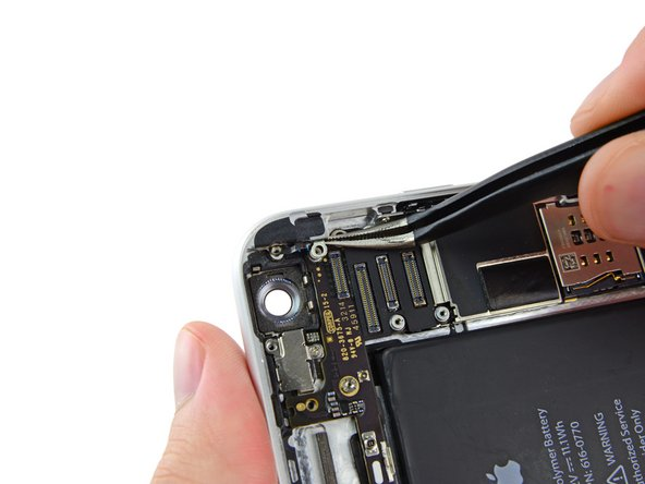 Carefully grasp the antenna clip with a pair of tweezers and remove it from the iPhone.