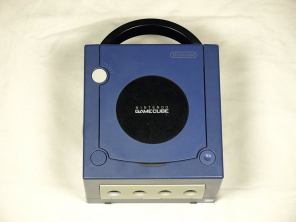 Turn over the Gamecube so that the bottom side is facing up.