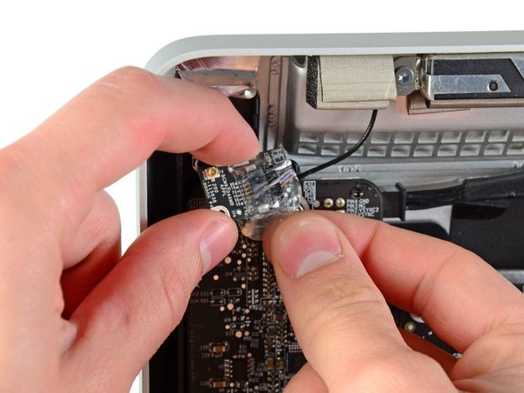 Remove the piece of tape wrapped around the Bluetooth board.