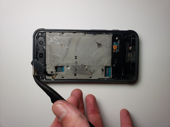 Use tweezers to take out the middle button and its connection to the motherboard.