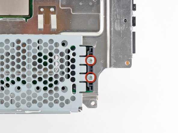 Remove the two 3.7 mm #0 Phillips screws securing the chassis to the hard drive socket.
