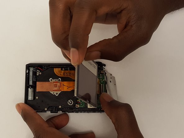 Carefully pull the LCD display up from the camera.