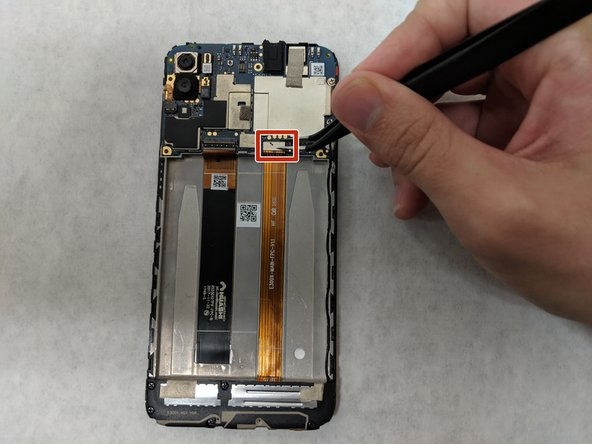 Right above the battery socket, pop up the press fit connector at the end of the orange ribbon cable on the right.