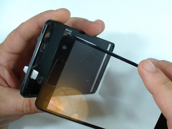 Check the LCD for dust and install the new touch screen glass.