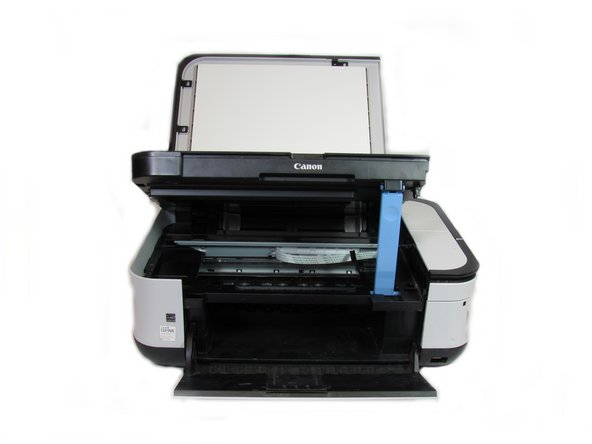 After opening up the scanner compartment, make sure the blue lever locks into place, keeping the compartment open.