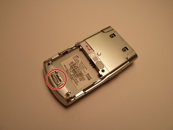 Use button to remove battery from the phone.