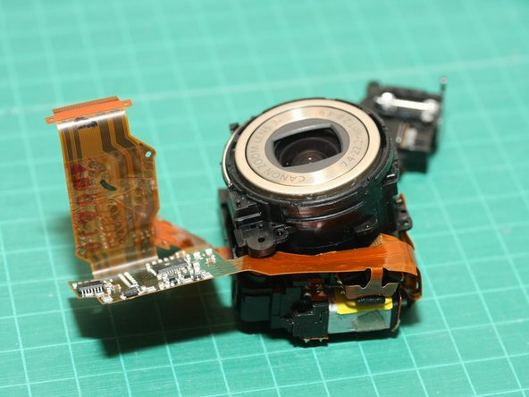 Wait!... not so fast. After reassembling the camera, I found a huge piece of dust on the sensor in all the new images I took. Dust must have entered the lens module during disassembly. I had to take the camera apart completely again!  This time, to open up and clean the lens module.   :-(