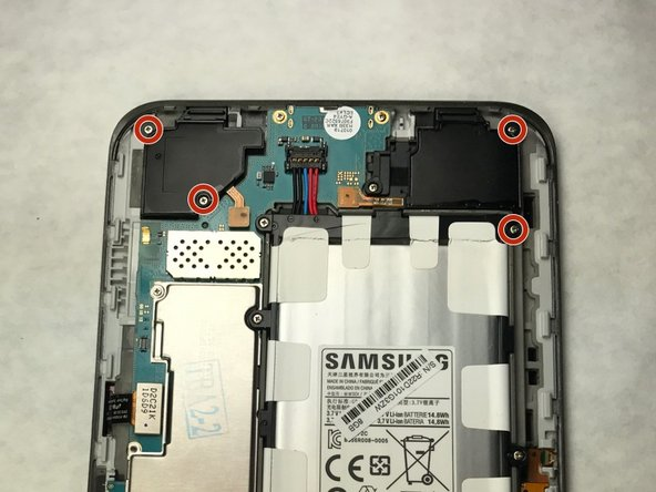 Using a phillips head screwdriver, remove the two 4mm screws holding down each speaker.