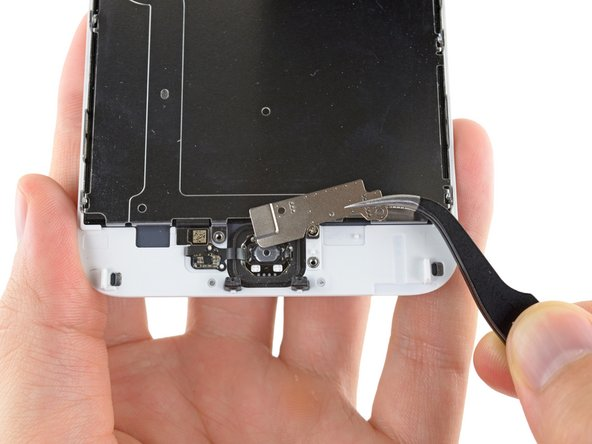 Remove the home button bracket from the front panel assembly.