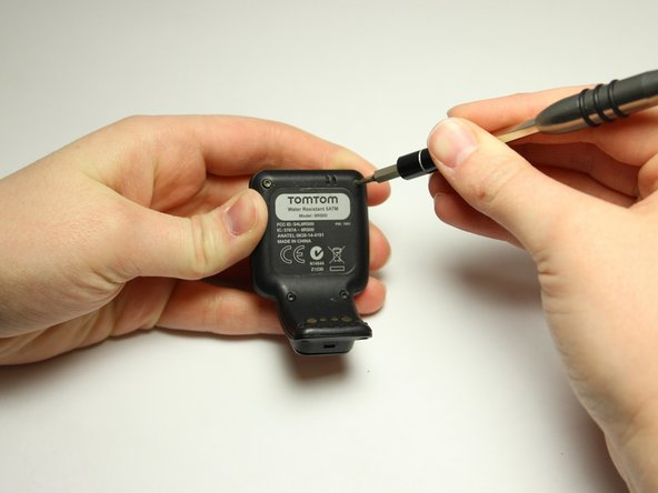 Flip over the watch and remove the four 3.0 mm Torx head screws with a T4 Torx head screwdriver.