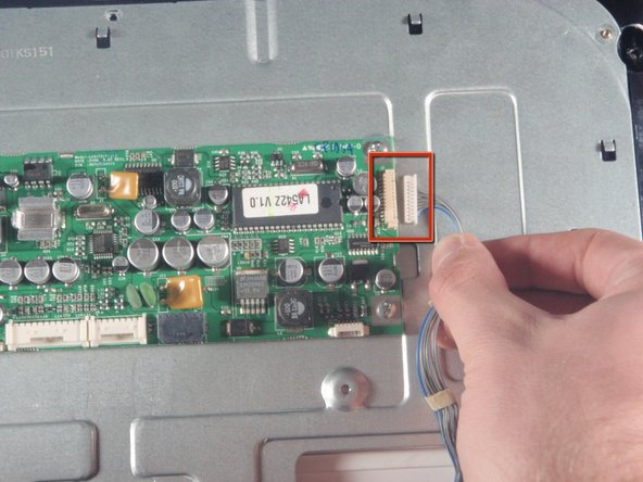 Remove top right connector of the LCD main board by pulling with hand.