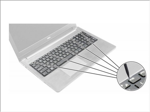 Release the keyboard by prying on the keyboard release tabs by using a scribe.