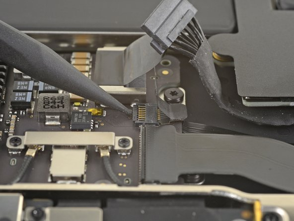 Use the tip of a spudger to lift up the locking flap on the fan cable's ZIF connector.