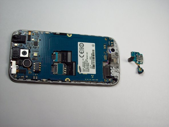 Once its released, gently lift the main board and remove the USB board containing the charging port.
