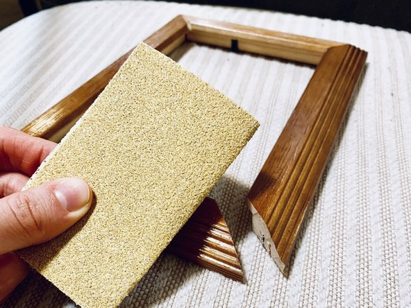 Begin to sand off the finish with the sandpaper if the frame appears to be scratched or damaged in any way