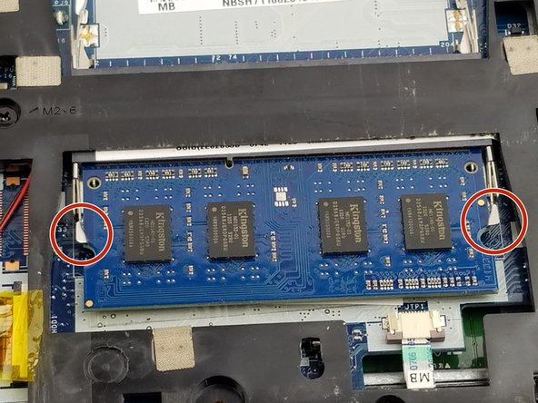 Locate the RAM and the metal clips holding the RAM in place.